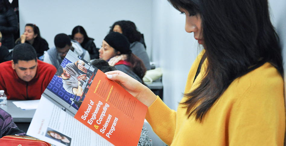 students viewing NYIT brochure