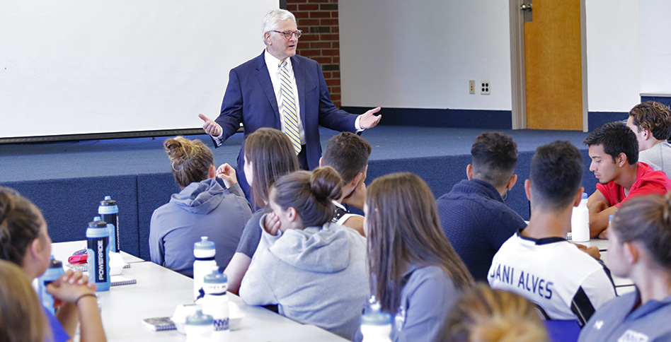 President Foley speaks with students
