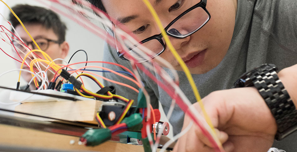 student working on computer circuits