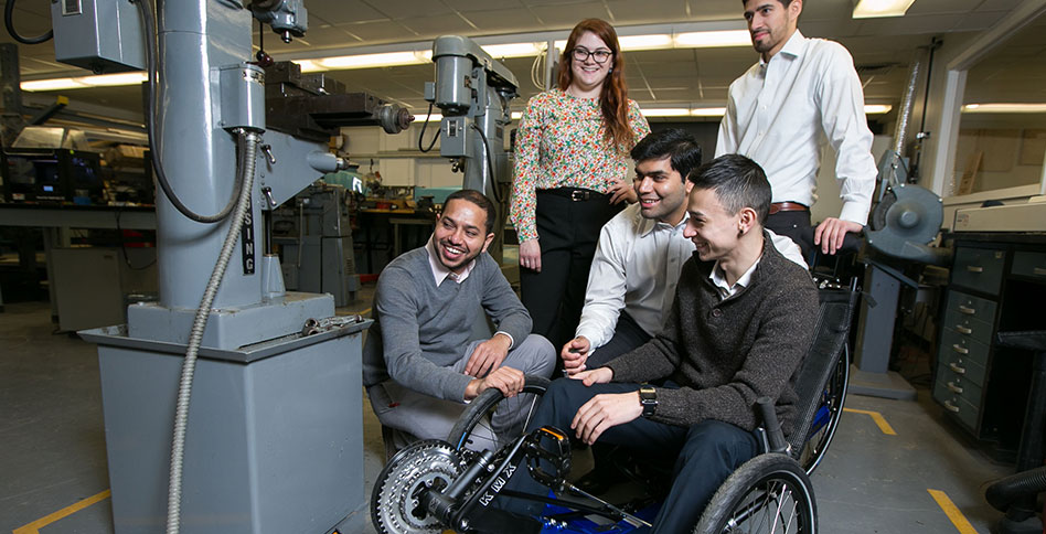 students working with automated wheelchair