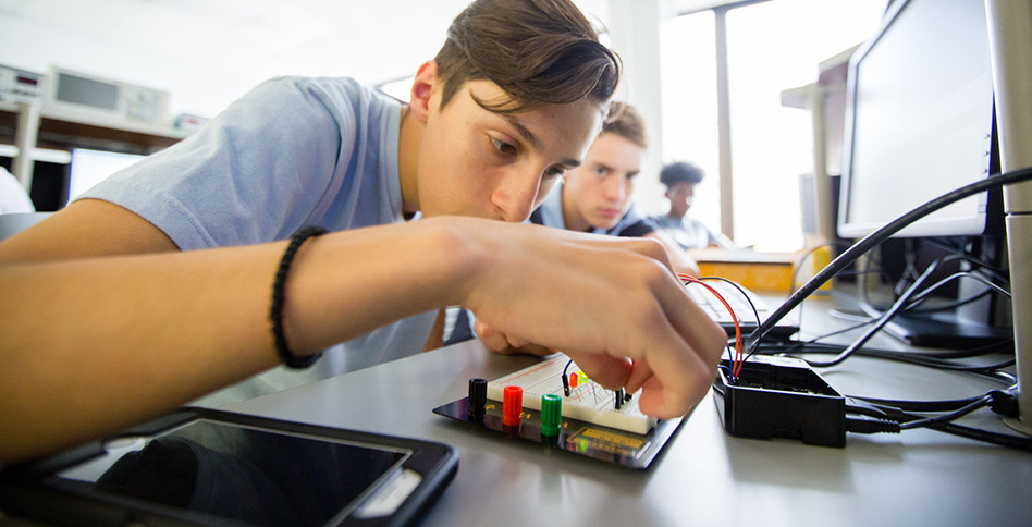 Student working on circuits