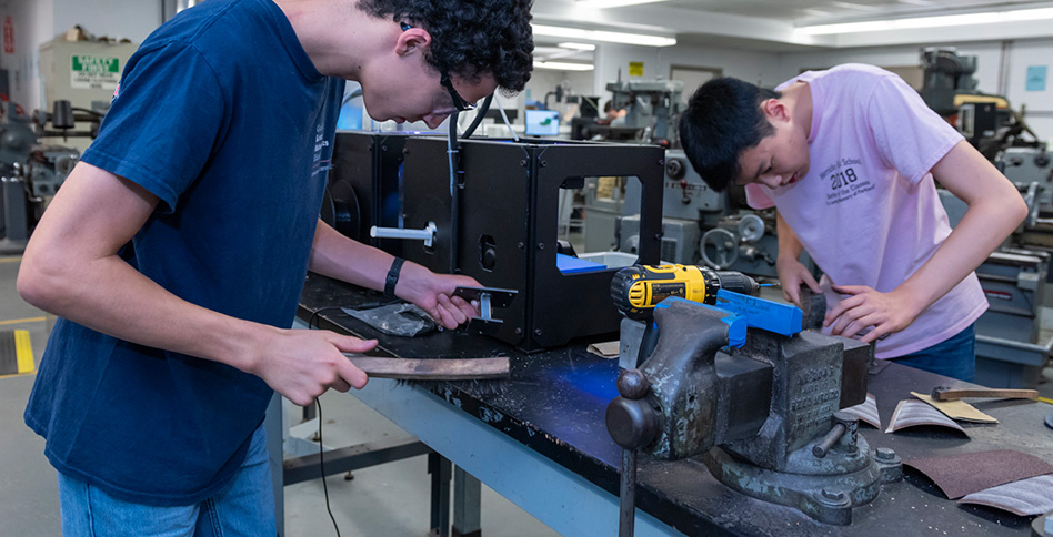 Students working on machine