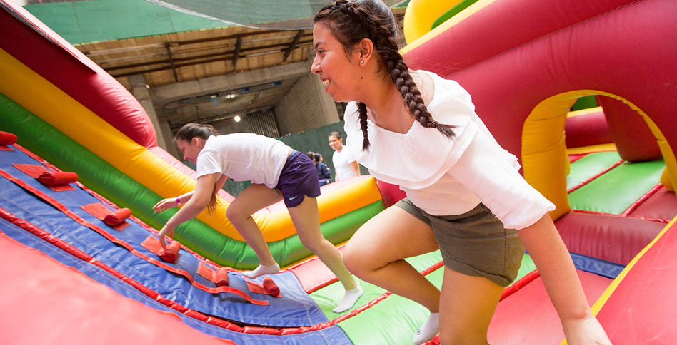 Students in bounce house