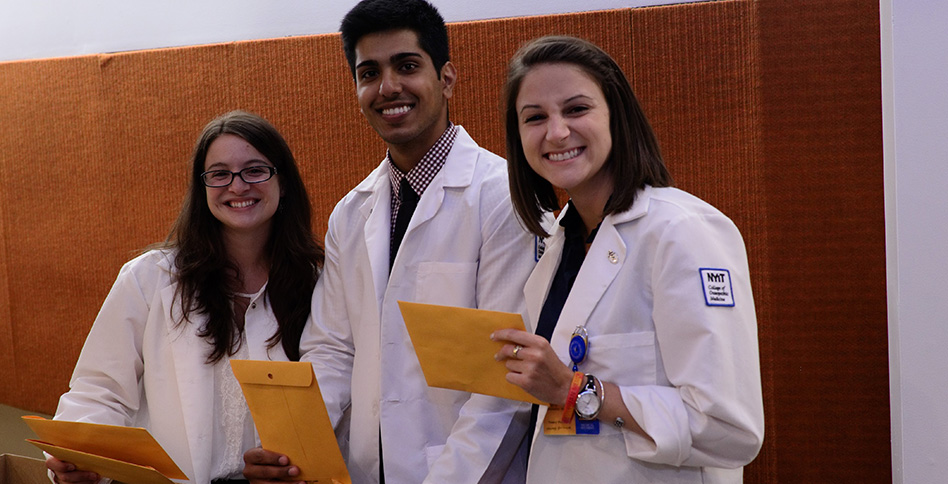 Medical students holding envelopes