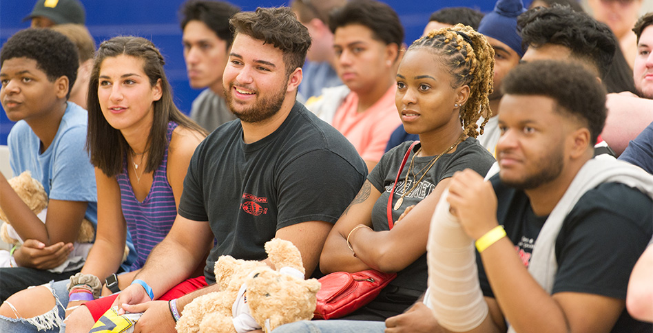 Students listen during assembly